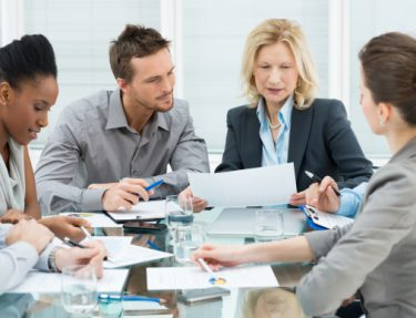 Group Of Coworkers Discussing In Conference Room